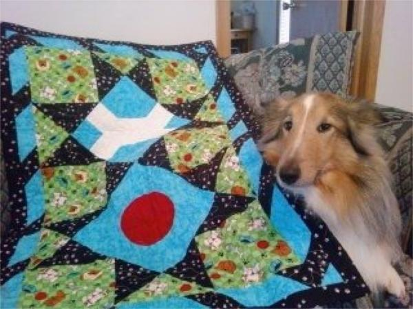Luke with his quilt