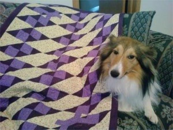 Cali with her quilt.