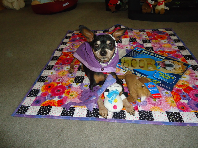Kiki with her quilt